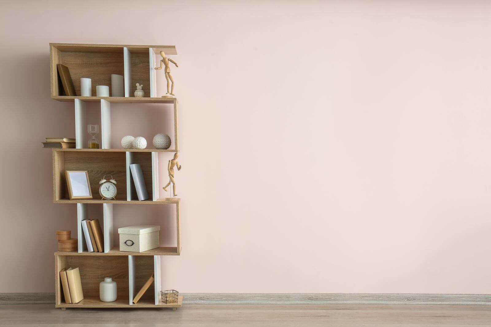 Modern shelf unit near light wall