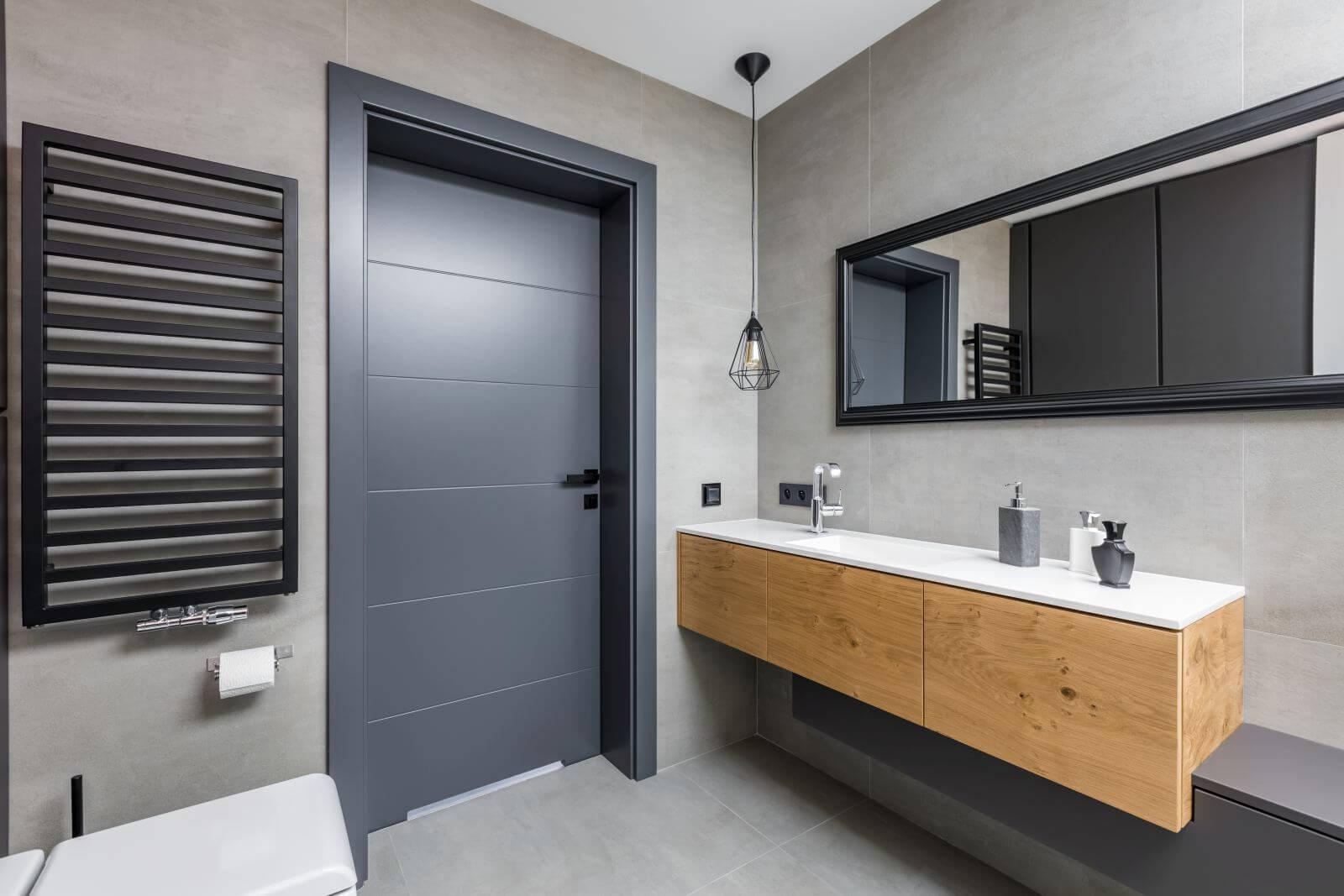 Dark and elegant bathroom with countertop basin and mirror
