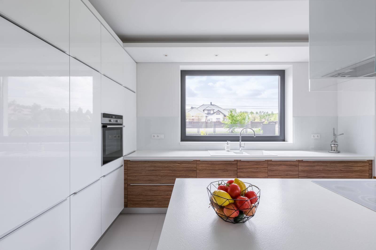 Modern design, white kitchen with island and big window