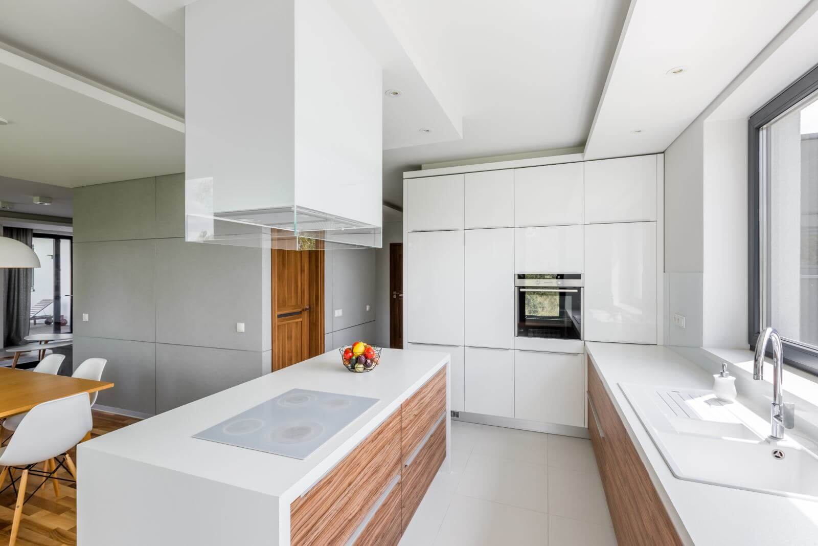 Luxurious white kitchen with island and wooden cupboards