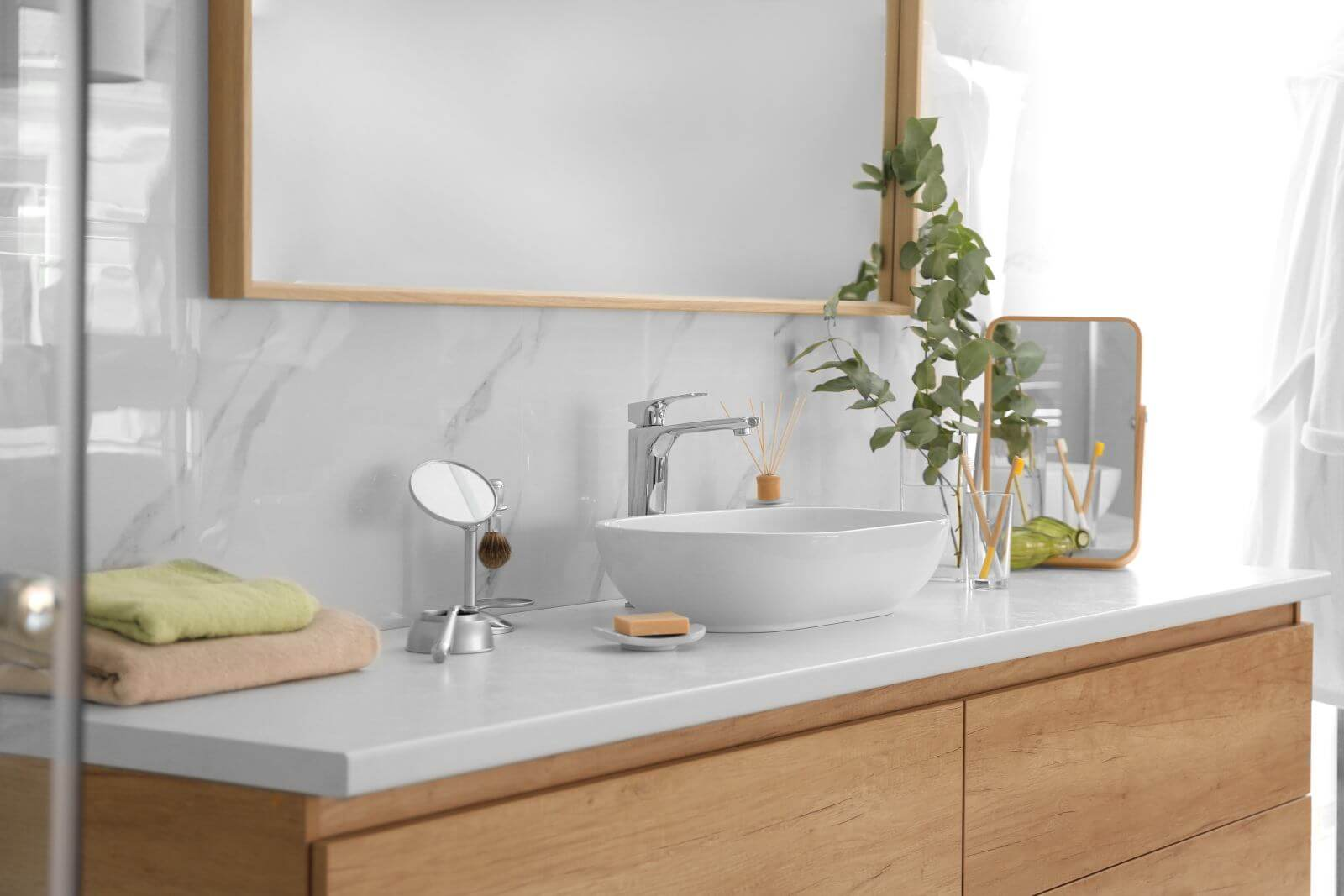 Modern bathroom interior with vessel sink and big mirror