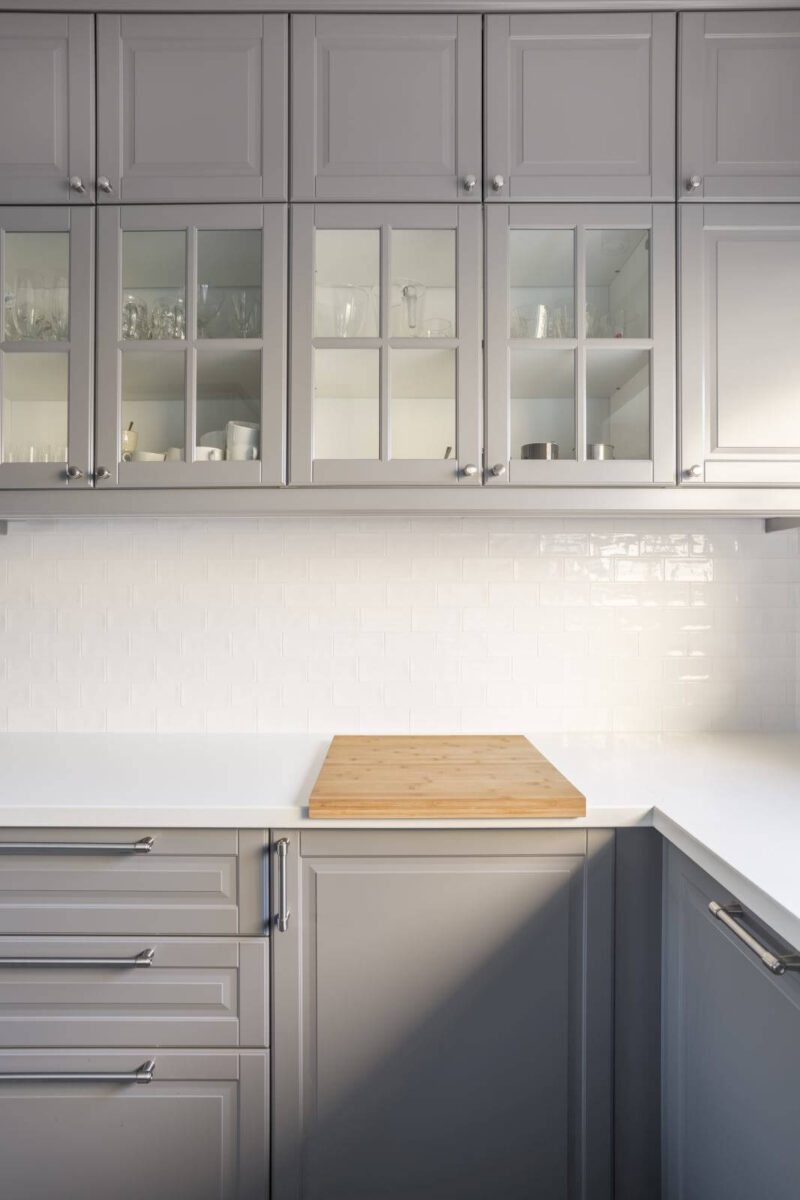 Kitchen with grey cupboards and white countertop