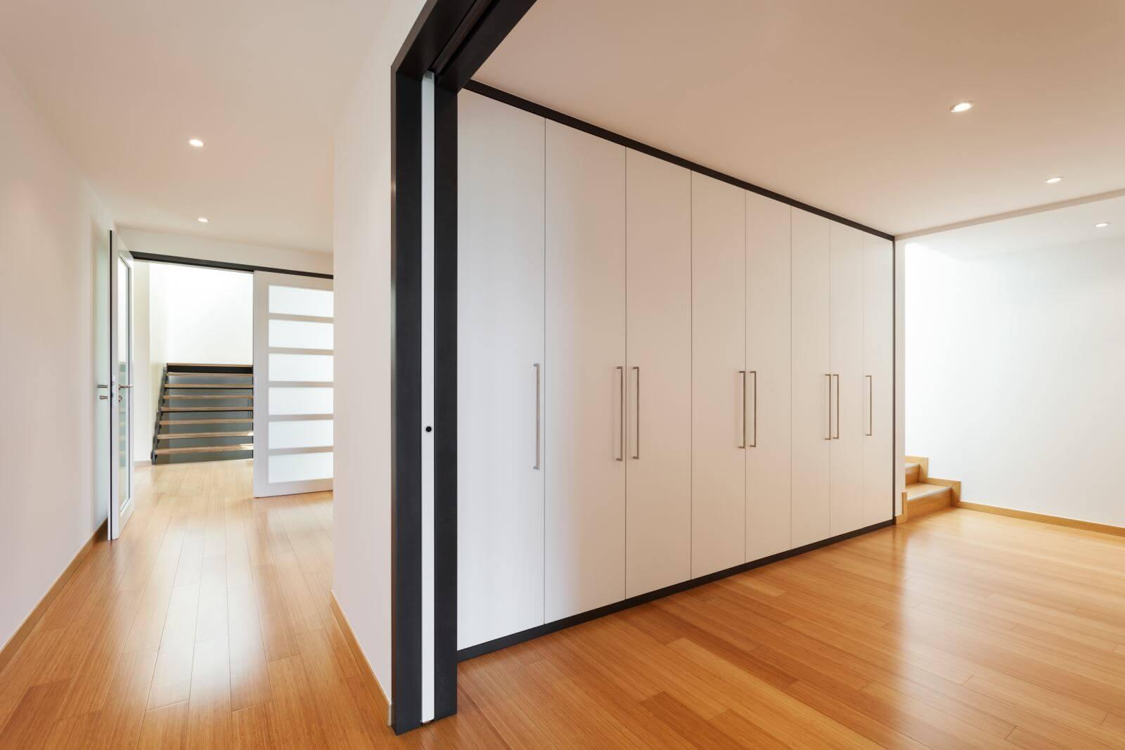 interior of a modern house, long corridor with wardrobes