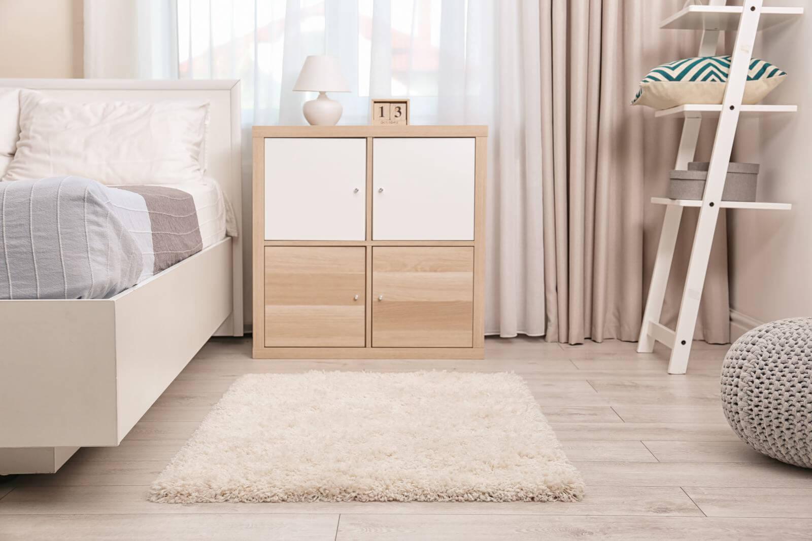 Modern bedroom interior with soft fluffy carpet