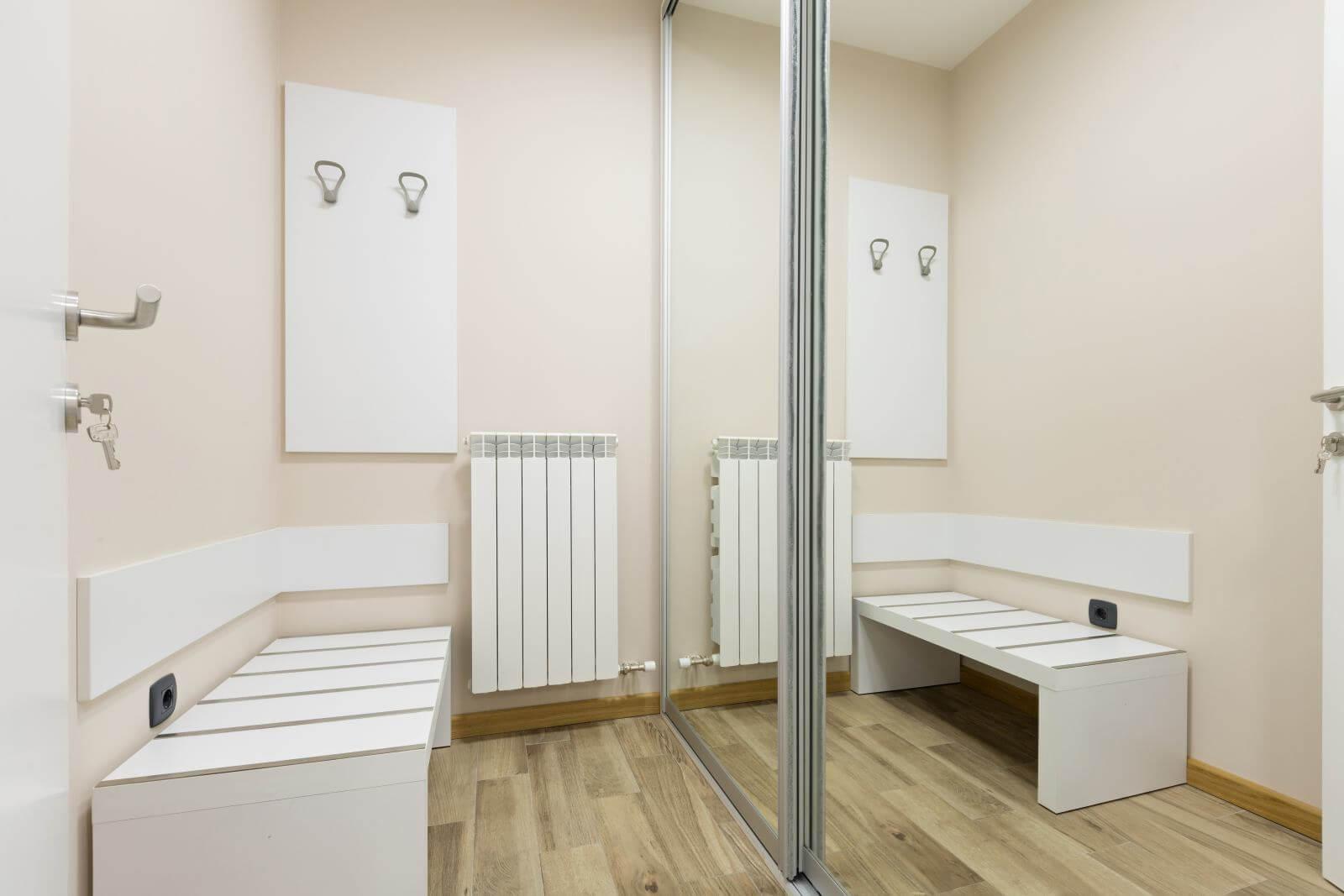 Corridor with closet and mirror