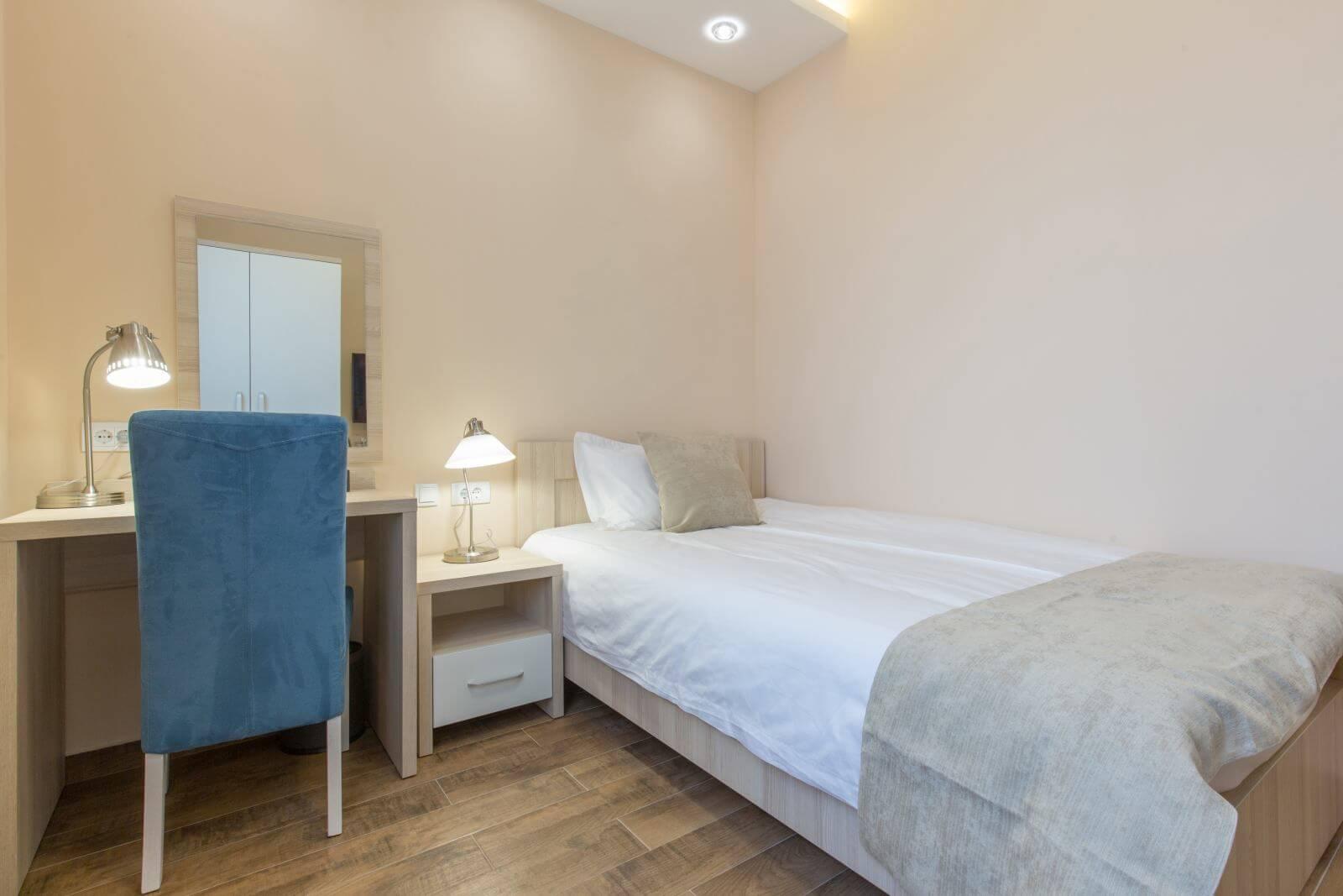 Hotel room interior, beige bedroom